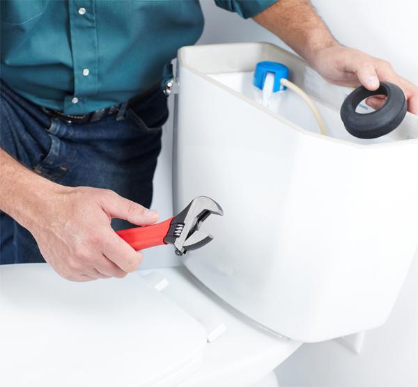 Tech Repairing a Toilet